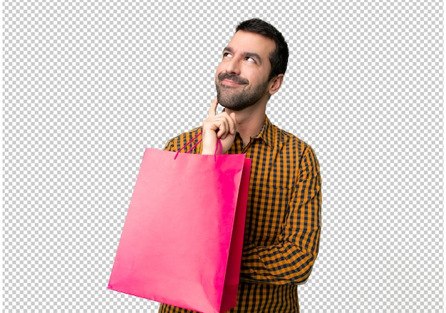 Man with shopping bags thinking an idea while looking up Premium Psd