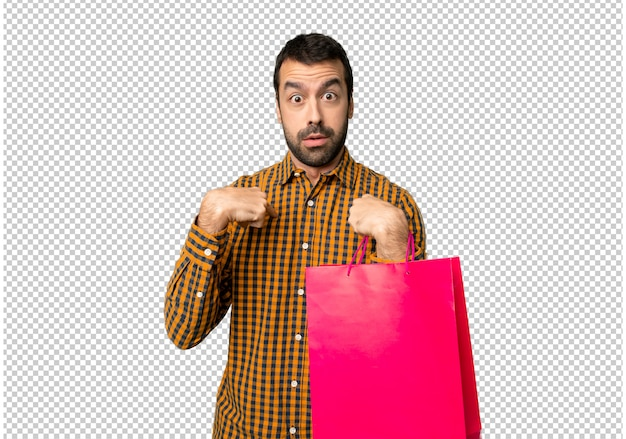 Man with shopping bags with surprise facial expression Premium Psd