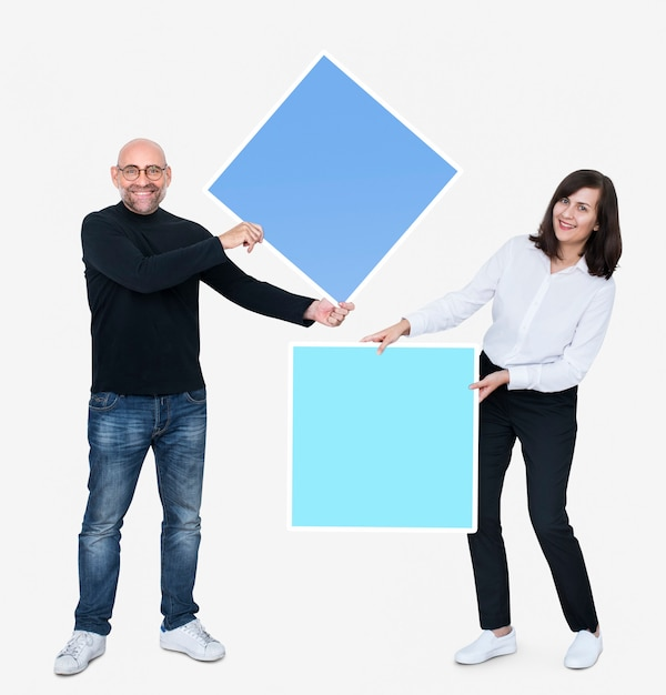 Man and woman holding squares Free Psd