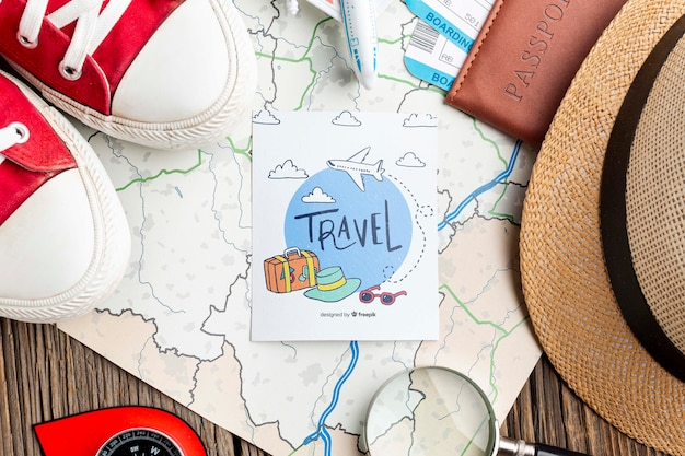 Map beside traveling tools mock-up Free Psd