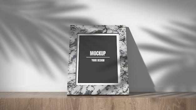 影の大理石のフォトフレームモックアップの葉の背景 Premium Psd