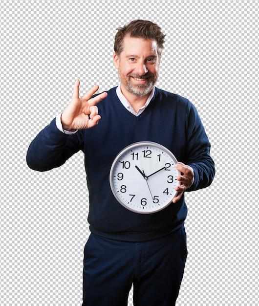 Mature man holding a clock Premium Psd