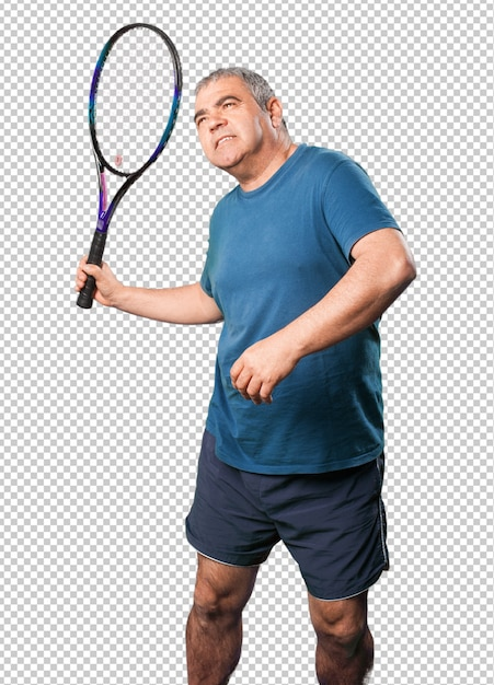 Mature man playing with a racket Premium Psd