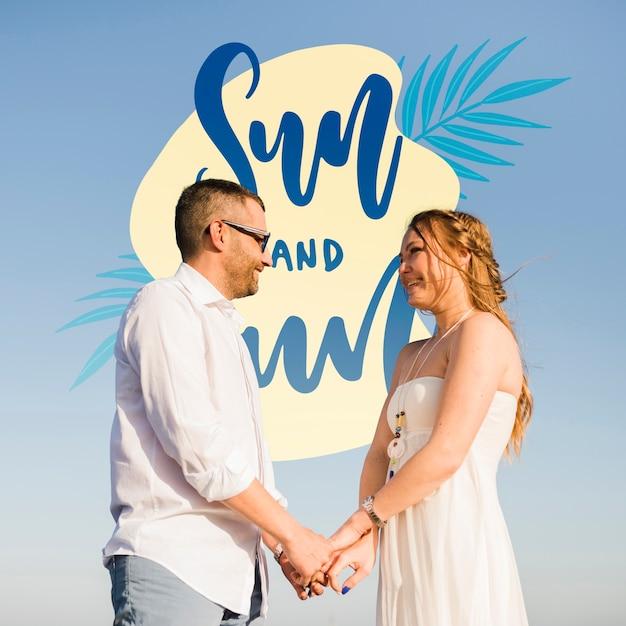 Medium shot of couple holding hands Free Psd