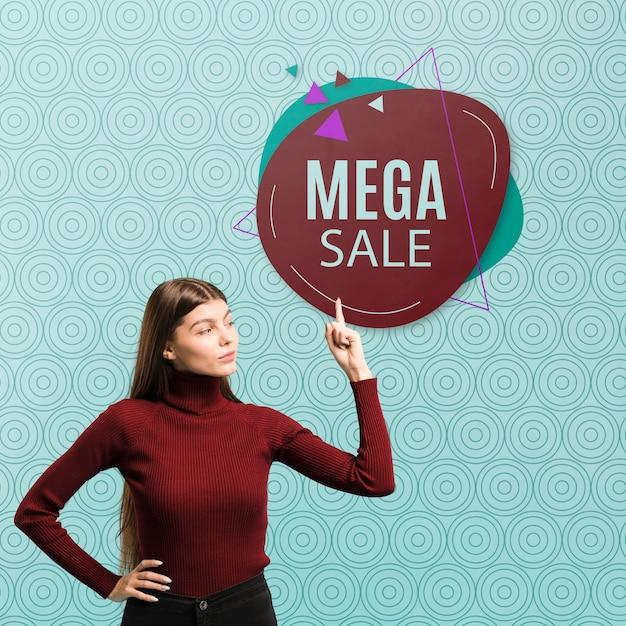 Medium shot woman pointing at mega sale Free Psd