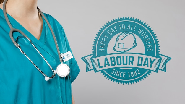 Medium view of woman with stethoscope and labour day badge Free Psd