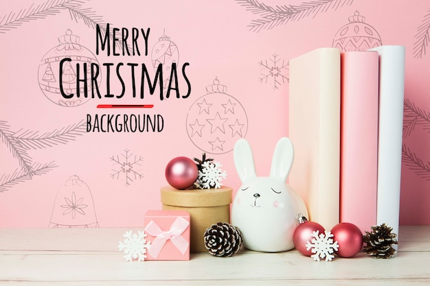 Merry christmas background arrangements with books and ornaments Free Psd