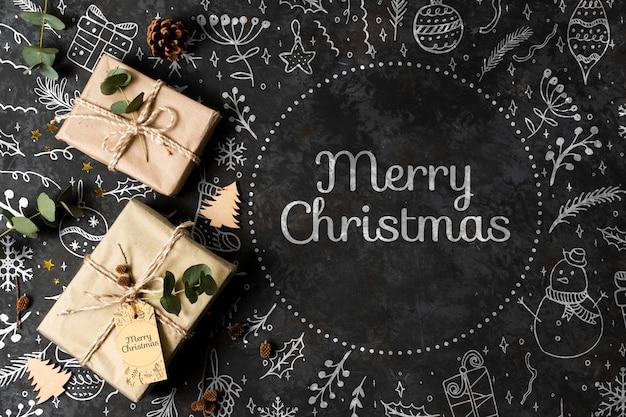 Счастливого рождества концепция с подарками на столе Бесплатные Psd