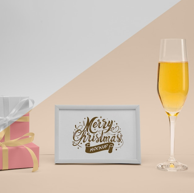 Merry christmas frame with champagne glass Free Psd
