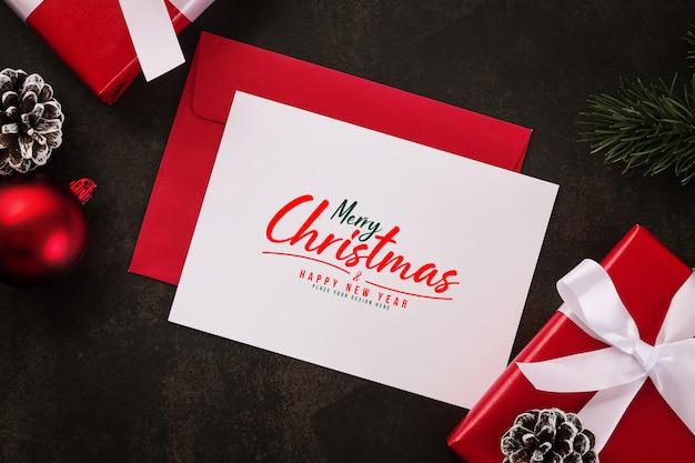 С рождеством христовым поздравительная открытка и макет конверта Premium Psd