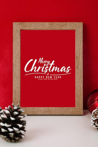 크리스마스 선물 장식 프레임 모형의 메리 크리스마스 인사말 카드 프리미엄 PSD 파일