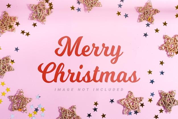 星と明るい紙吹雪の装飾が施されたメリークリスマスのグリーティングカード Premium Psd