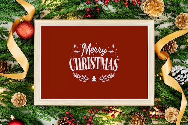 Merry christmas greeting in a frame mockup Free Psd