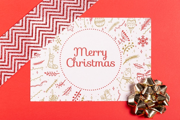 Merry christmas mock-up paper with bow and ribbon Free Psd
