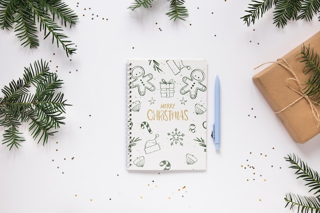Merry christmas notebook on a table Free Psd
