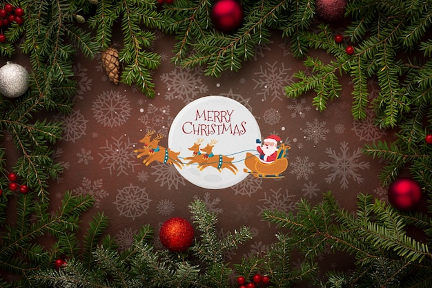 Merry christmas with santa and christmas pine leaves Free Psd