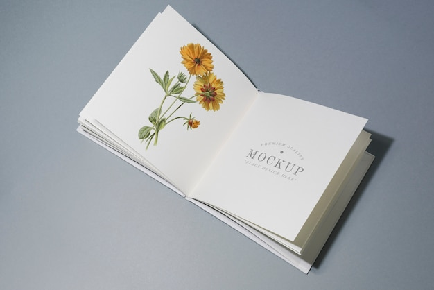 Mid fold book mockup with floral illustration Free Psd
