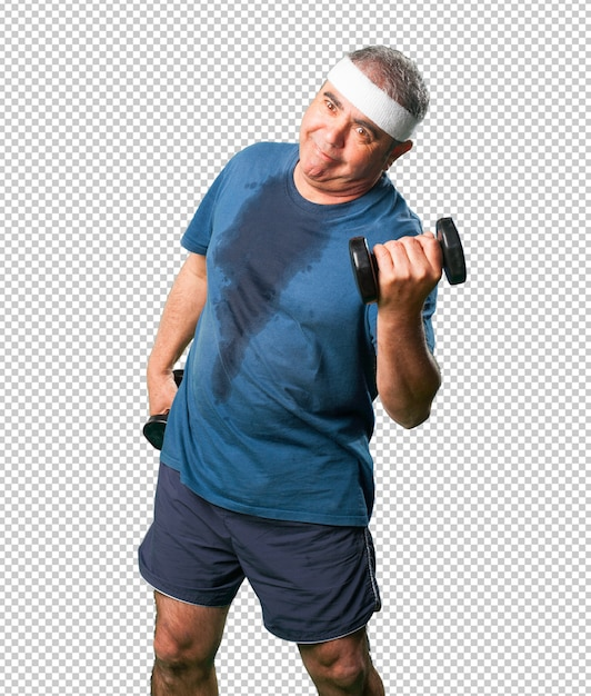 Middle aged man doing exercise with dumbbells Premium Psd