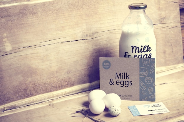 Milk and eggs with business card mockup Premium Psd