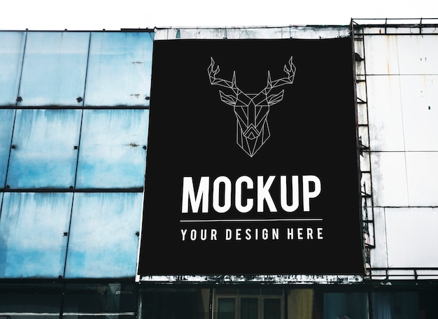Minimal large-scale vertical billboard mockup Free Psd