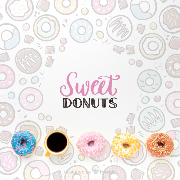 Mix of colorful donuts and coffee with mock-up Free Psd