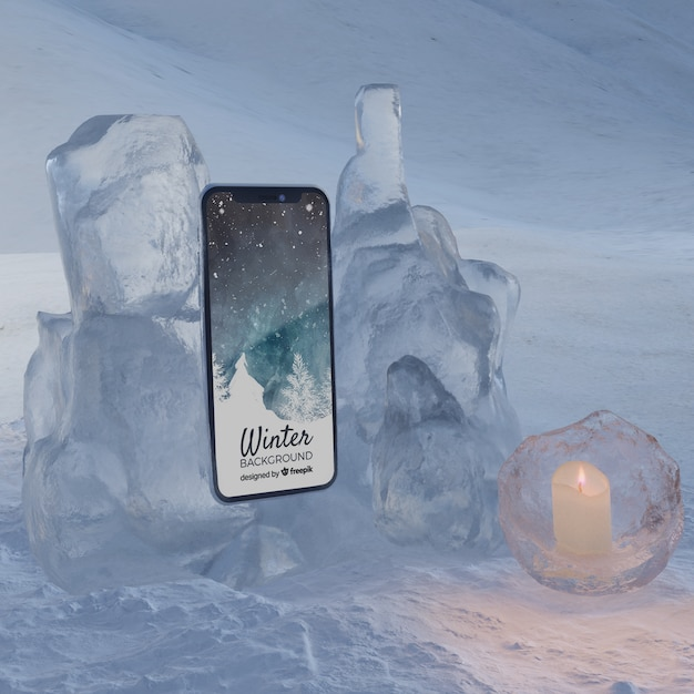 Mobile on ice block light by candle Free Psd