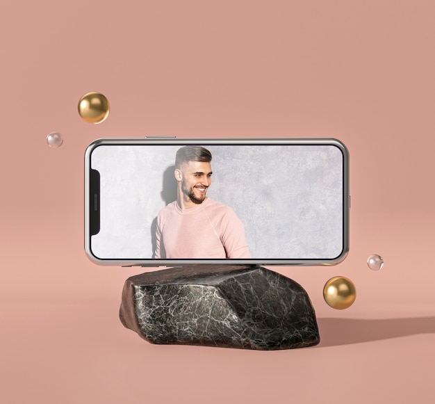 Mobile phone 3d mock-up on marble rock Free Psd