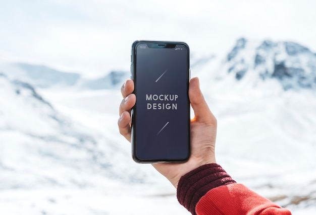 Mobile phone mockup design by the himalaya mountains Premium Psd