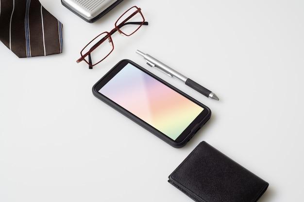 Mobile phone mockup with gentlemen's accessories Premium Psd