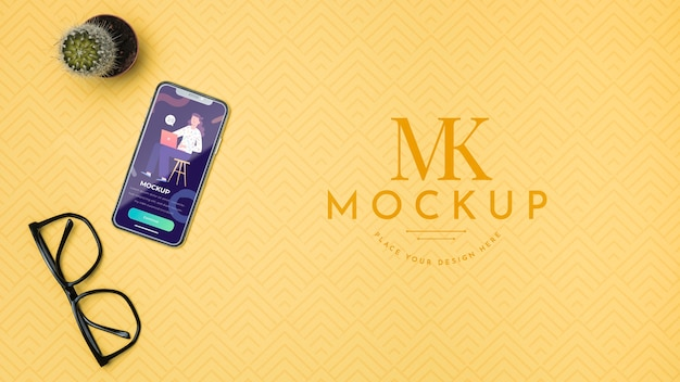 Mobile phone and reading glasses mock-up Free Psd