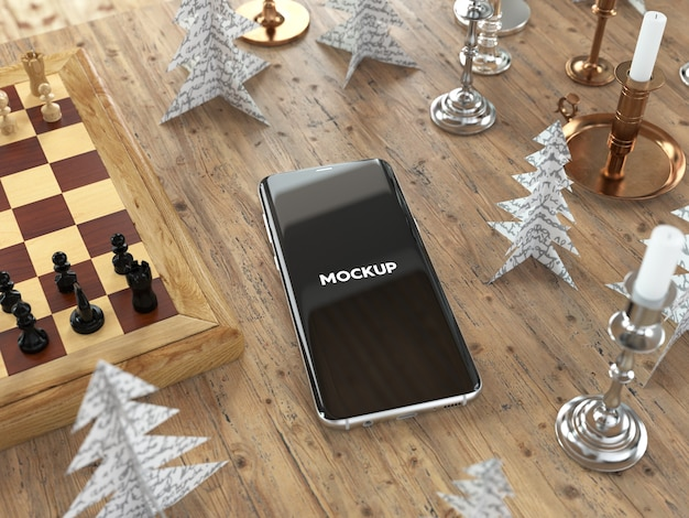 Mobile phone on table with chest mock up design Free Psd
