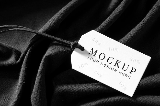 Mock-up of clothing label on black soft fabric Free Psd