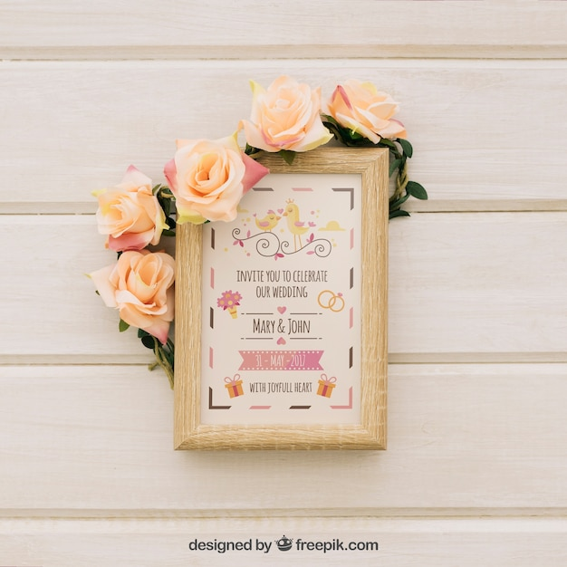 Mock up design of wooden frame with flowers PSD file | Free Download