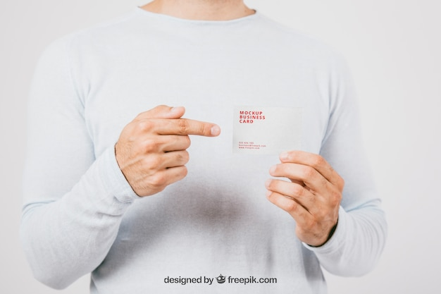 Макет дизайна с визитной карточкой и указательным пальцем Бесплатные Psd