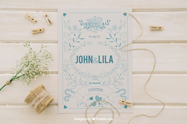 Mock up design with wedding invitation and ornaments Free Psd