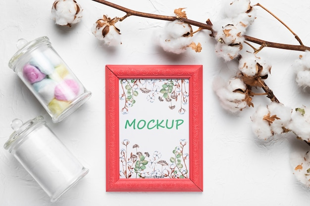 Mock-up frame surrounded by cotton Free Psd