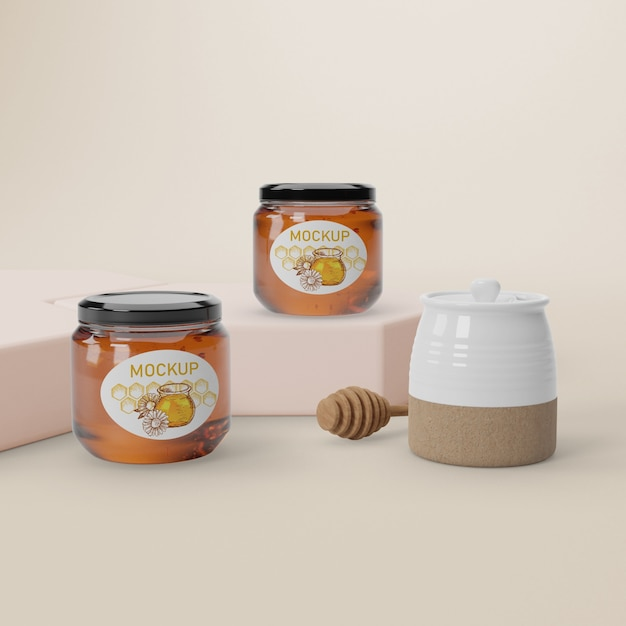 Mock-up jars on table with honey Free Psd