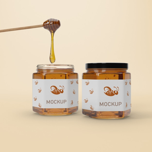 Mock-up jars with honey on table Free Psd
