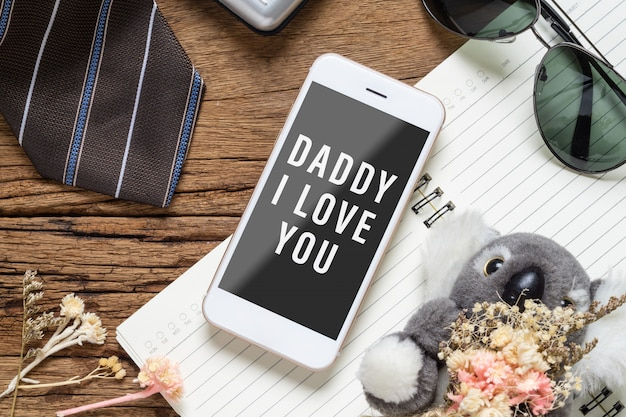 Mock up mobile phone for your artwork with father's accessories items and daughter's toy Premium Psd