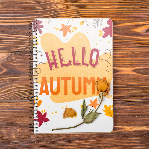 Mock-up notebook with hello autumn message Free Psd