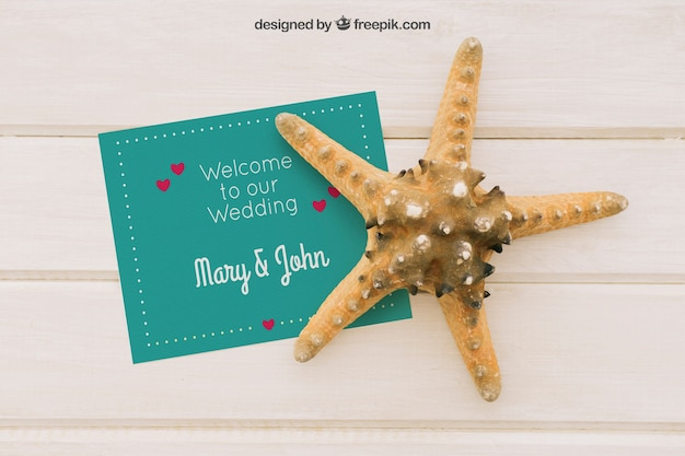 Mock up with wedding invitation and starfish Free Psd