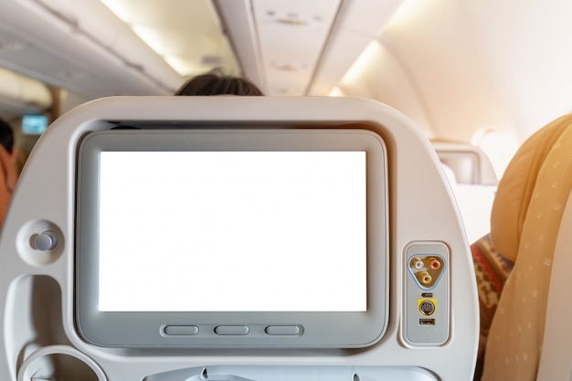 Mockup of aircraft monitor on cabin in passenger seat plane interior Premium Psd