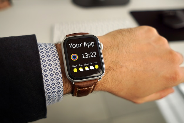 Mockup for app on a watch on male hand Premium Psd