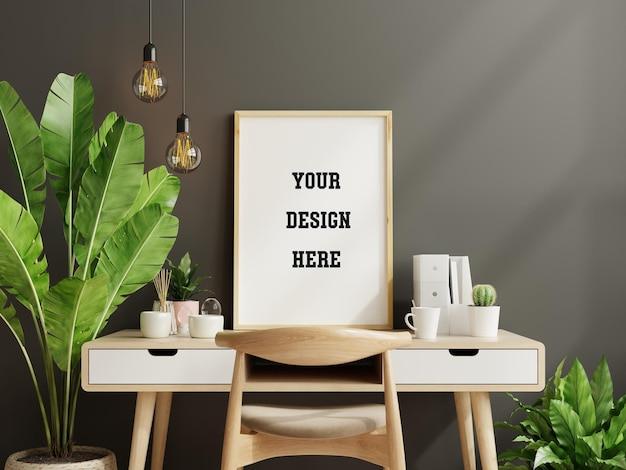 Mockup black frame on work table in living room interior on empty dark wall background,3d rendering Premium Psd