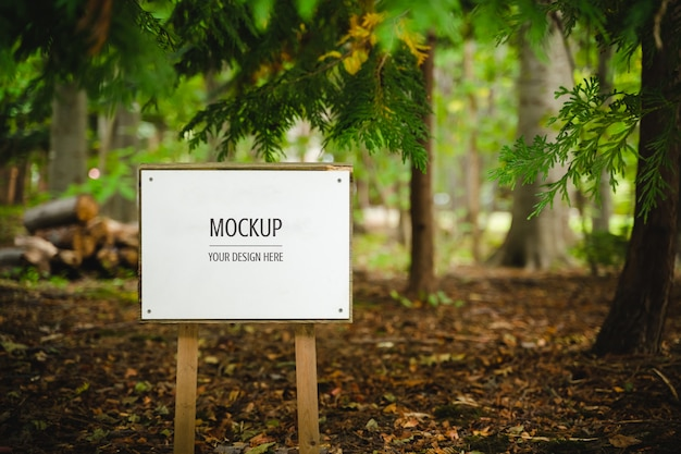 Mockup of blank white wooden board in the forest Premium Psd