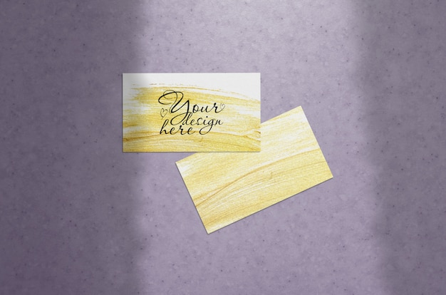 Mockup of business card on a pupur background with shadow of curtains Premium Psd