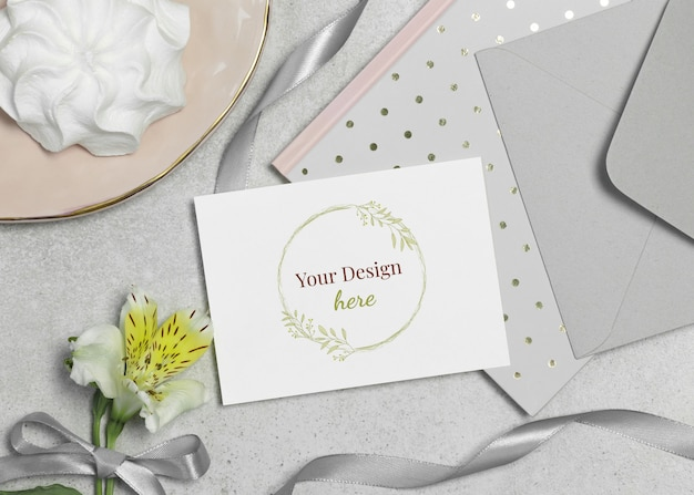 Mockup card with flower, marshmallow and ribbon on grey background Premium Psd