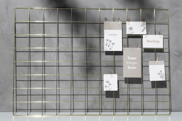 Mockup cards hanging on grid memo board Free Psd