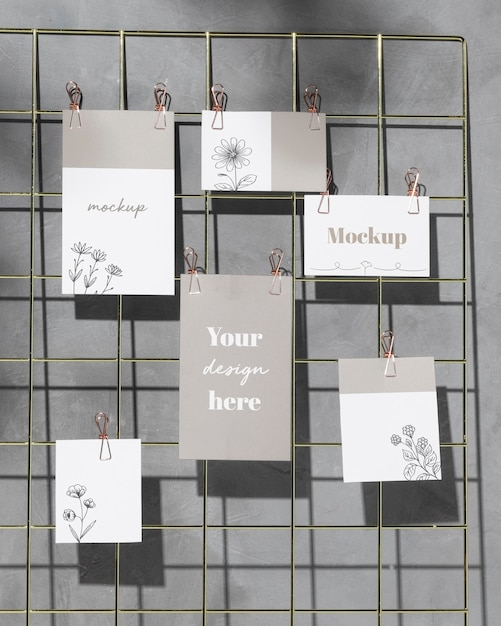Mockup cards hanging on grid wire board Free Psd