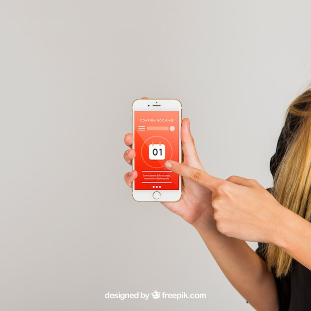 Mockup concept of finger pointing at smartphone Free Psd